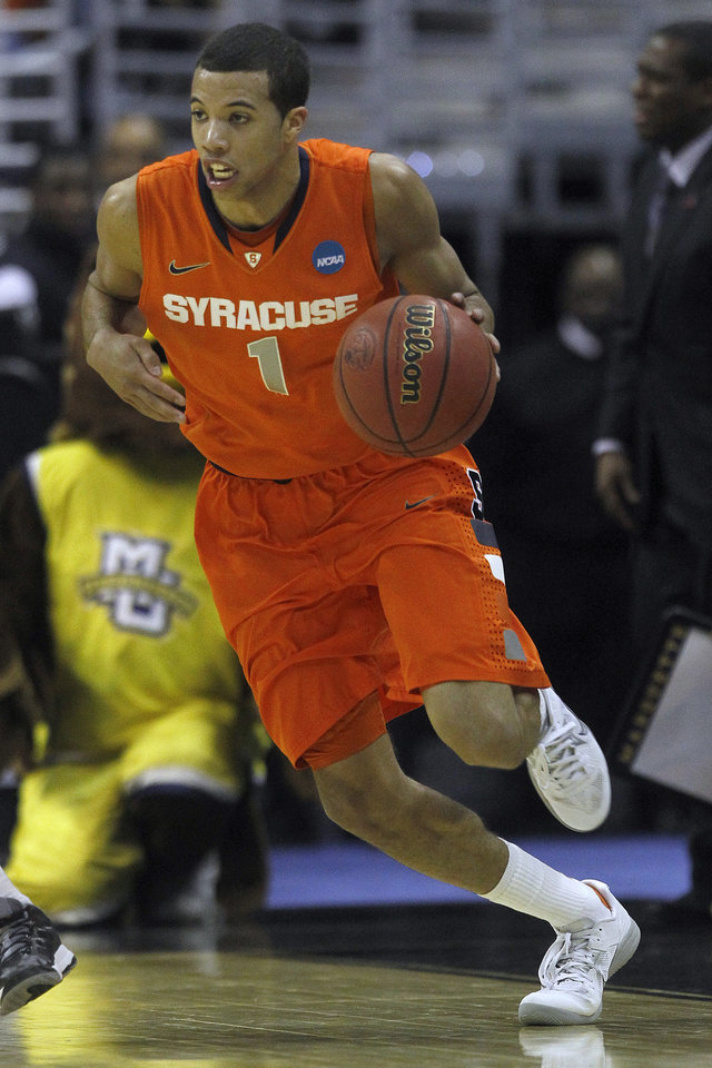 Syracuse guard Michael Carter-Williams (1) drives the ball during the second half of the East Regional final in the NCAA men\'s college basketball tournament, Saturday, March 30, 2013 in Washington. (AP Photo/Pablo Martinez Monsivais)