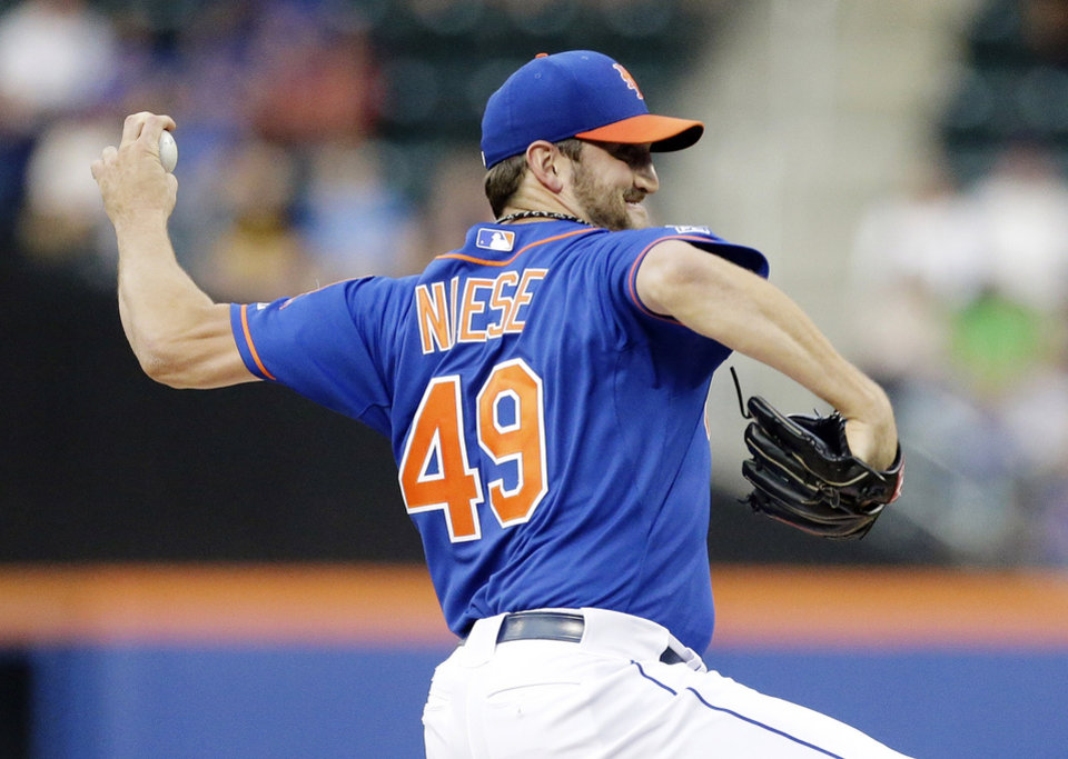 Photo - New York Mets' Jonathon Niese (49) delivers a pitch during the first inning of a baseball game against the Chicago Cubs, Saturday, Aug. 16, 2014, in New York. (AP Photo/Frank Franklin II)