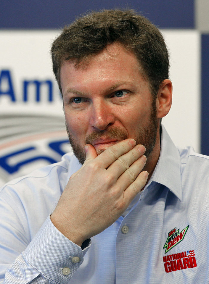 Photo -   Dale Earnhardt Jr. pauses as he talks about missing the next two races with his second concussion in the past six weeks during a news conference prior to practice for Saturday's NASCAR Bank of America 500 NASCAR Sprint Cup series auto race in Concord, N.C., Thursday, Oct. 11, 2012. (AP Photo/Chuck Burton)