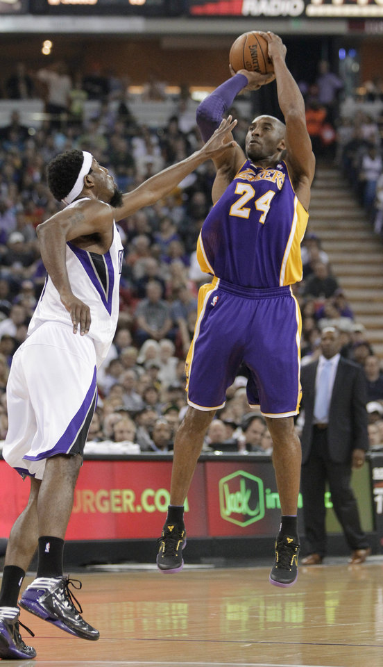 Los Angeles Lakers guard Kobe Bryant, right, shoots over Sacramento Kings forward John Salmons during the first quarter of an NBA basketball game in Sacramento, Calif., Saturday, March 30, 2013. (AP Photo/Rich Pedroncelli)