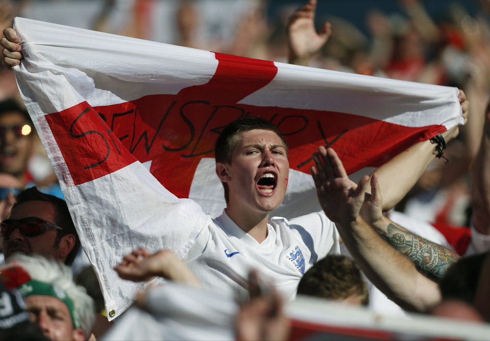 Photo - An England fan shouts during the group D World Cup soccer match between Costa Rica and England at the Mineirao Stadium in Belo Horizonte, Brazil, Tuesday, June 24, 2014. (AP Photo/Jon Super)