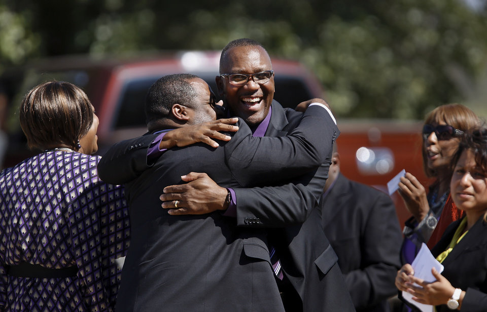 Former major league baseball player Joe Carter, Sr., is hugged after the funeral.  About 400 family and friends gathered inside the Millwood High School Fieldhouse on  Tuesday,  Sep, 25, 2012, to honor the life and say farewell to Joseph D. Carter, Sr. at a funeral service that was sentimental and touching, but also full of joy and laughter. Carter is survived by a wife and their 11 children as well as 46 grandchildren, 35 great-grandchildren and 10 great-great-grandchildren. Photo by Jim Beckel, The Oklahoman.