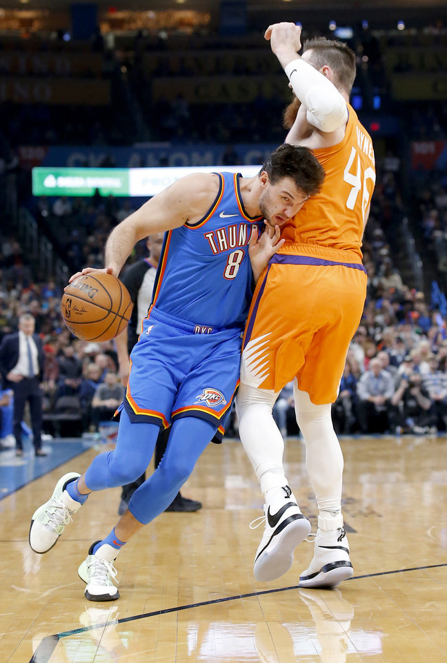 Photo - Oklahoma City's Danilo Gallinari (8) looks to  get around Phoenix's Aron Baynes (46) during the NBA basketball game between the Oklahoma City Thunder and the Phoenix Suns at the Chesapeake Energy Arena in Oklahoma City , Friday, Dec. 20, 2019.   [Sarah Phipps/The Oklahoman]