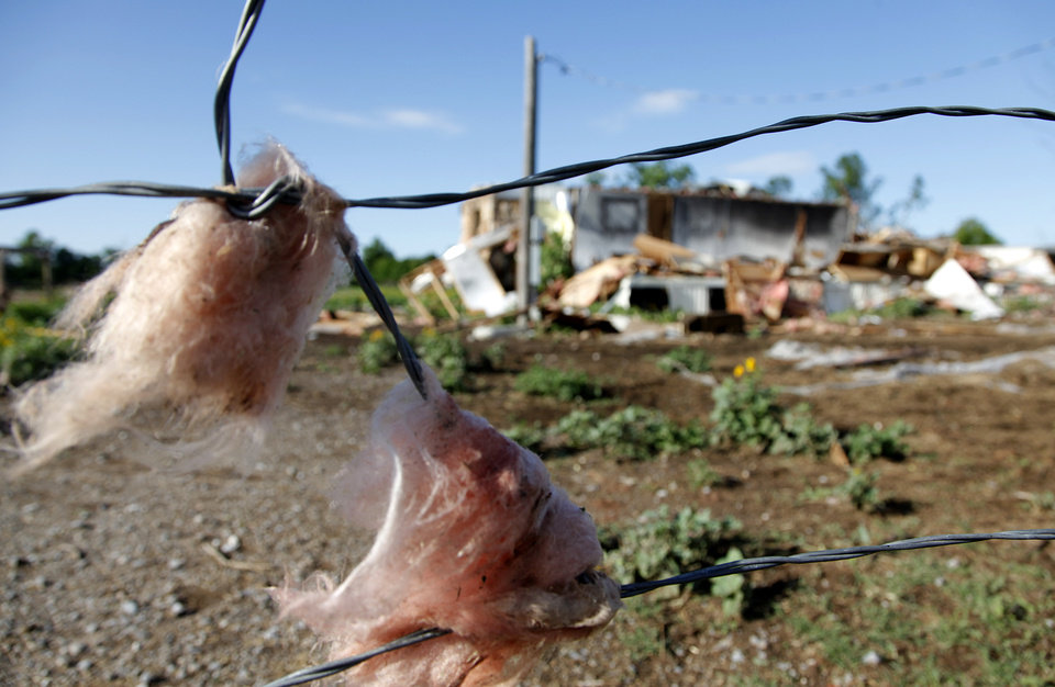 Insulation is stuck to a fence from home destroyed by Tuesday's tornado west of El Reno, Wednesday, May 25, 2011. Photo by Chris Landsberger, The Oklahoman
