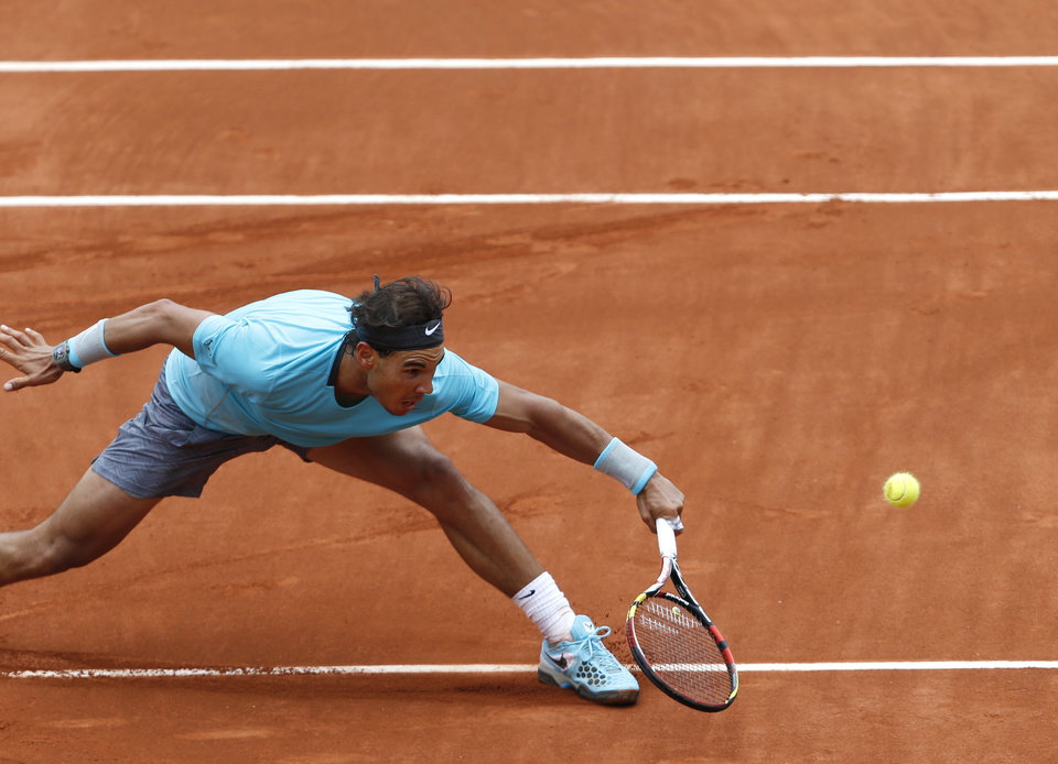 Photo - Spain's Rafael Nadal returns the ball to Austria's Dominic Thiem during the second round match of  the French Open tennis tournament at the Roland Garros stadium, in Paris, France, Thursday, May 29, 2014. Nadal won 6-2, 6-2, 6-3. (AP Photo/Darko Vojinovic)