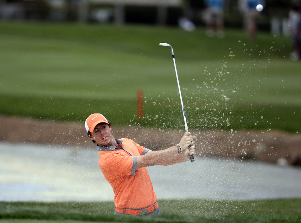 Photo - Rory McIlroy, of Northern Ireland, hits out of a bunker onto the 18th green during the first round of the Honda Classic golf tournament, Thursday, Feb. 27, 2014, in Palm Beach Gardens, Fla. McIlroy ended the day at 7 under par. (AP Photo/Lynne Sladky)