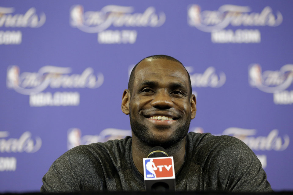 Photo - Miami Heat small forward LeBron James smiles as he speaks during a news conference before NBA basketball practice, Wednesday, June 19, 2013 at the American Airlines Arena in Miami. The Heat host the San Antonio Spurs in Game 7 of the NBA Finals on Thursday. (AP Photo/Wilfredo Lee)