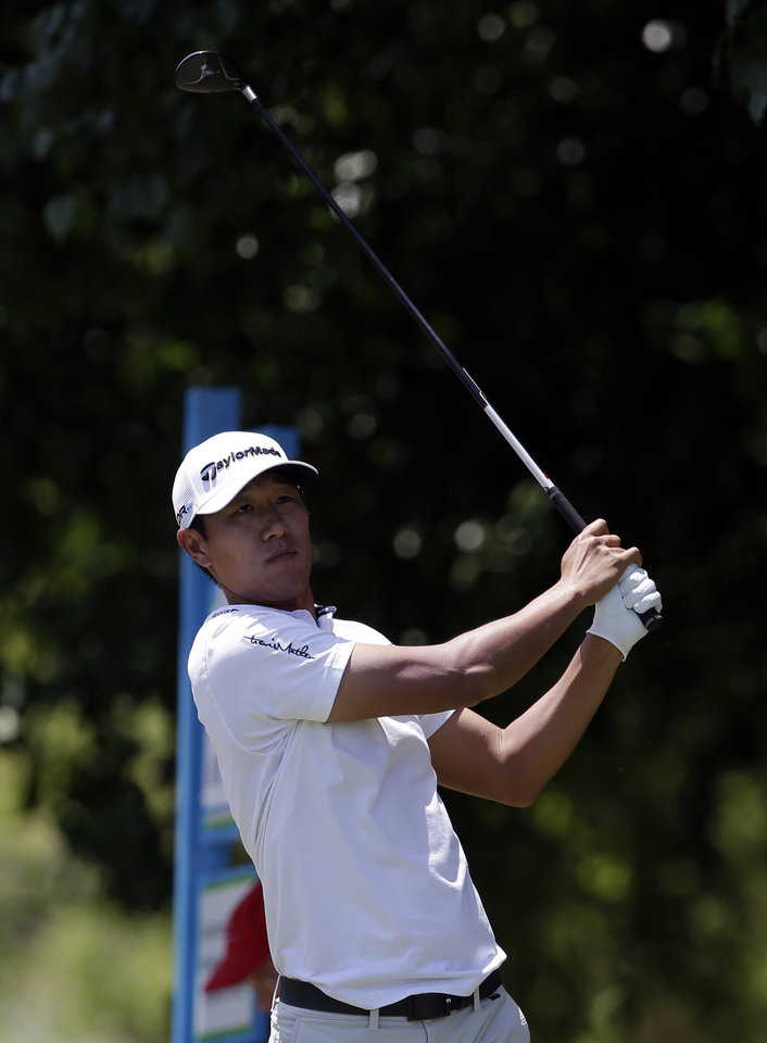 Photo - James Hahn follows his shot off the first tee during the final round of the Byron Nelson Championship golf tournament, Sunday, May 18, 2014, in Irving, Texas. (AP Photo/Tony Gutierrez)