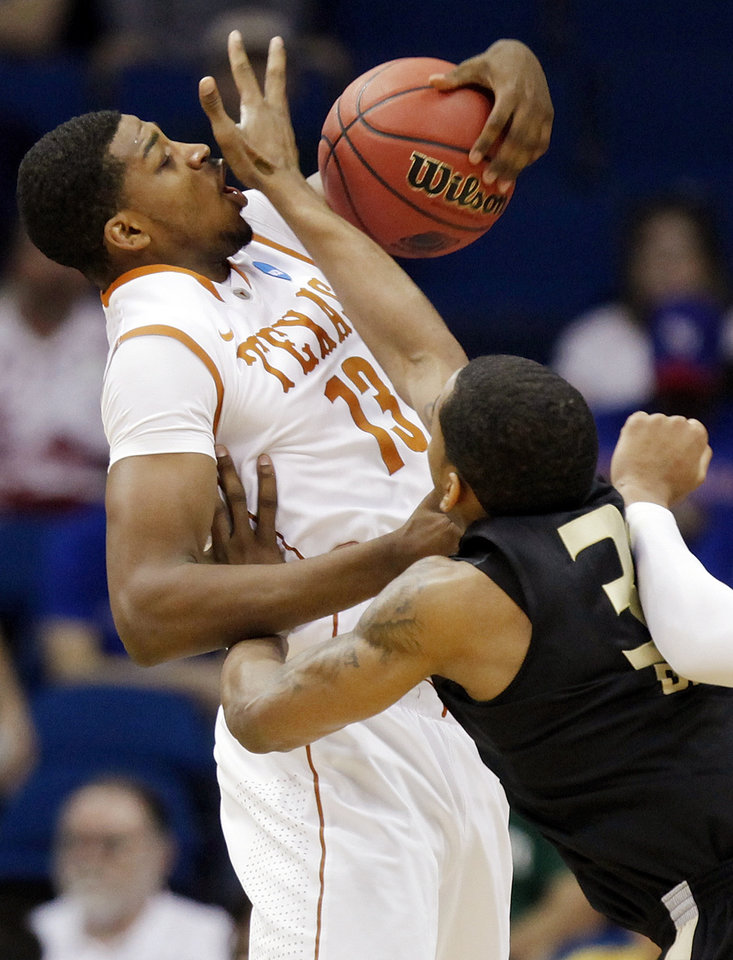Photo - Oakland's Keith Benson (34) defends Tristan Thompson (13) of Texas in the first half during the NCAA men's basketball tournament second round game between Oakland and Texas at the BOK Center in Tulsa, Okla., Friday, March 18, 2011.  Photo by Nate Billings, The Oklahoman