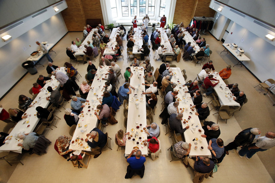 Customers line the tables Tuesday at the annual Benefit Bean Dinner sponsored by the Christian Men's Fellowship at First Christian Church in Norman. The dinner raises money for Health for Friends' medication fund. PHOTO BY STEVE SISNEY, THE OKLAHOMAN <strong>STEVE SISNEY</strong>
