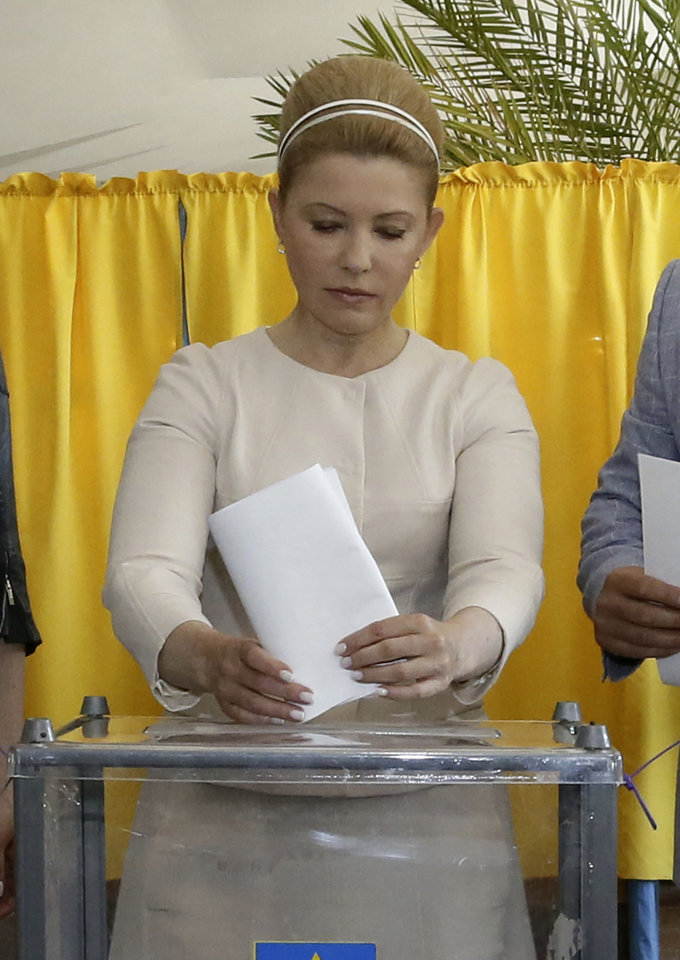 Photo - Ukraine's presidential candidate Yulia Tymoshenko casts her ballot at a polling station during the presidential election in Dnipropetrovsk, Ukraine, Sunday, May 25, 2014. Ukraine's critical presidential election got underway Sunday under the wary scrutiny of a world eager for stability in a country rocked by a deadly uprising in the east.(AP Photo/Olexander Prokopenko)