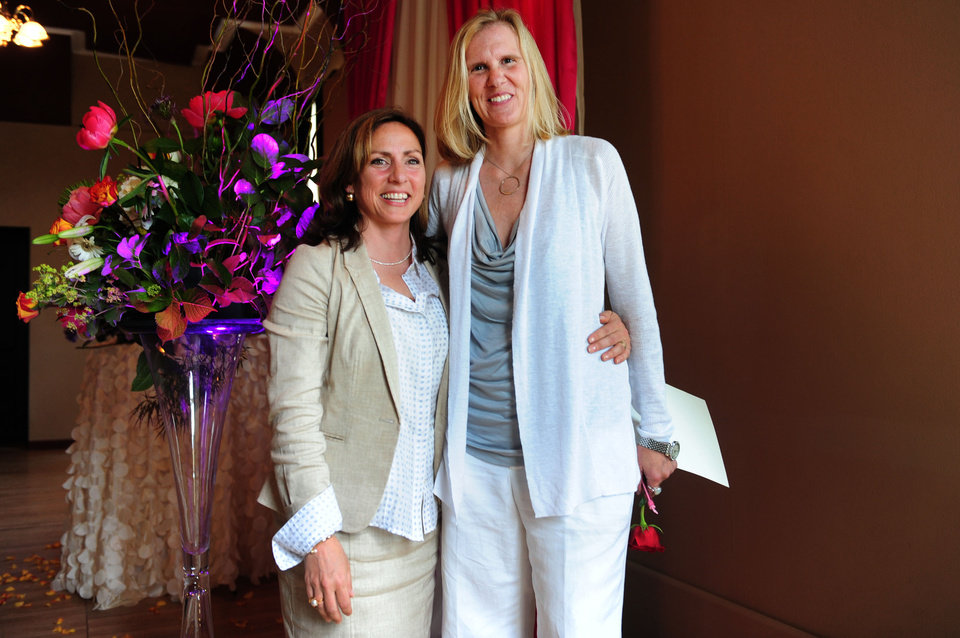 Photo - Julie Engbloom, right,  and Laurie Brown  pose after getting married at the Melody Ballroom in Portland, Ore. on Monday, May. 19, 2014. Federal Judge Michael McShane released an opinion on Oregon's Marriage Equality lawsuit that grants gay and lesbian couples the freedom to marry in Oregon. (AP Photo/Steve Dykes)