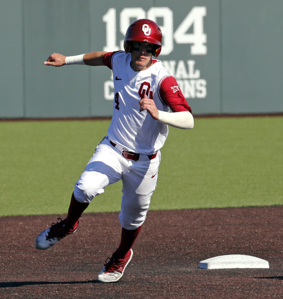 Photo - Oklahoma's Brandon Zaragoza (4) runs the bases as the University of Oklahoma Sooner (OU) baseball team plays the West Virginia Mountaineers  in a college baseball at L. Dale Mitchell Park on Saturday, March 24, 2018 in Norman, Okla. Photo by Steve Sisney, The Oklahoman