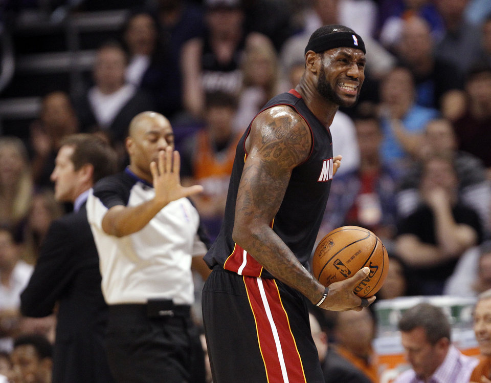 Photo - Miami Heat forward LeBron James argues a foul called during the first quarter an NBA basketball game against the Phoenix Suns on Tuesday, Feb. 11, 2014, in Phoenix. (AP Photo/The Arizona Republic, Michael Chow) MAGS OUT  NO SALES  MESA OUT  MARICOPA COUNTY OUT