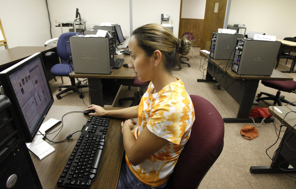Maribel Flores uses a computer in Oklahoma City Community College�s Capitol Hill Center. The college is temporarily using classroom space in Capitol Hill United Methodist Church. Photo By Steve Gooch, The Oklahoman