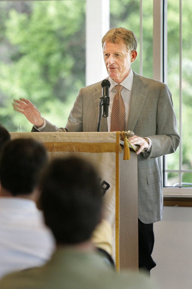 Photo - OSU athletics director Mike Holder spoke last week to the Edmond Rotary Club. He said he expects a