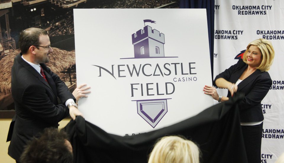 RedHawks President and General Manager Michael Byrnes and Newcastle Casino marketing manager Jennifer Cross unveil the new logo during the press conference to announce the new name for the ballpark. Newcastle Field at Bricktown where the Redhawks will play their home games Wednesday, April 4, 2012. Photo by Doug Hoke, The Oklahoman