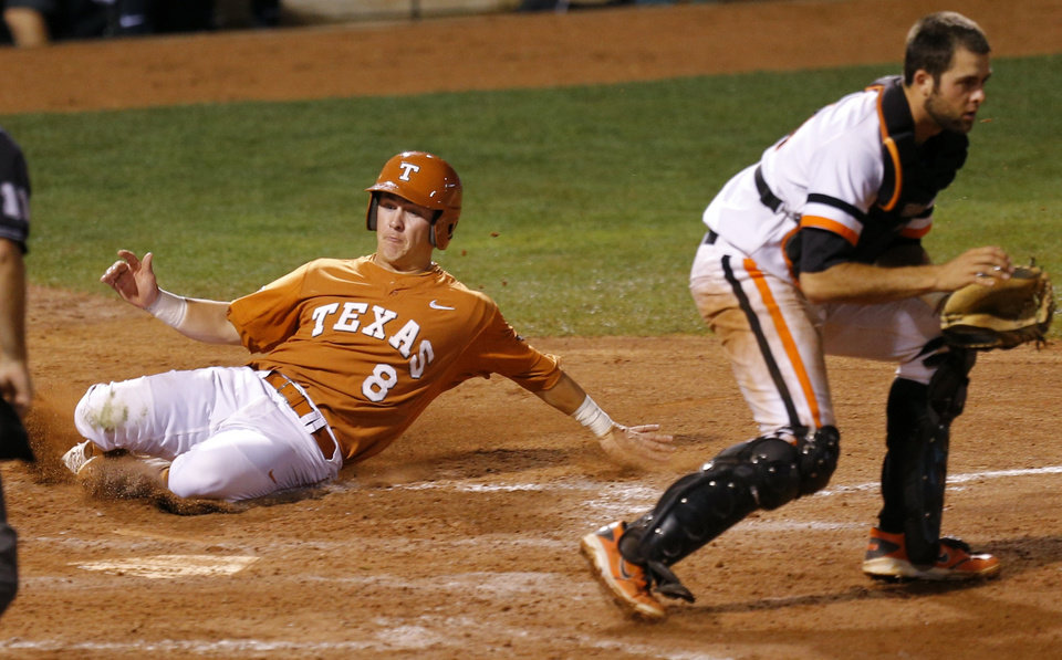 Photo - Texas' Brooks Marlow scores past OSU's Bryan Case in the sixth inning during a Big 12 Tournament baseball game between Oklahoma State University and the University of Texas at Chickasaw Bricktown Ballpark in Oklahoma City, Saturday, May 24, 2014. Photo by Bryan Terry The Oklahoman