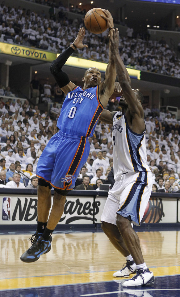 Oklahoma City Thunder guard Russell Westbrook (0) shoots against Memphis Grizzlies guard Tony Allen, right, during the first half of Game 6 of a second-round NBA basketball playoff series on Friday, May 13, 2011, in Memphis, Tenn. (AP Photo/Lance Murphey)