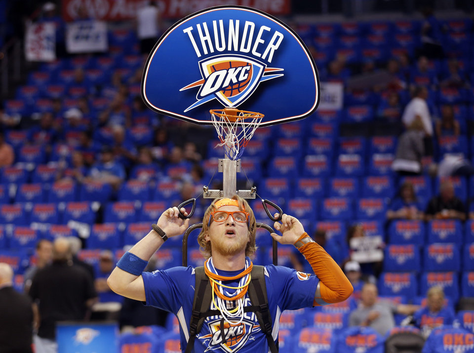Photo - A storm chaser entertains the crowd before Game 7 in the first round of the NBA playoffs between the Oklahoma City Thunder and the Memphis Grizzlies at Chesapeake Energy Arena in Oklahoma City, Saturday, May 3, 2014. Photo by Sarah Phipps, The Oklahoman