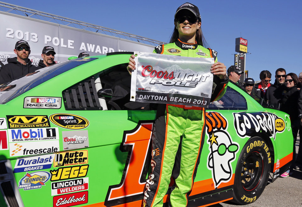 Photo - Danica Patrick displays the flag after winning the pole during qualifying for the NASCAR Daytona 500 Sprint Cup Series auto race at Daytona International Speedway, Sunday, Feb. 17, 2013, in Daytona Beach, Fla. Patrick won the pole, becoming the first woman to secure the top spot for any Sprint Cup race. (AP Photo/Terry Renna)