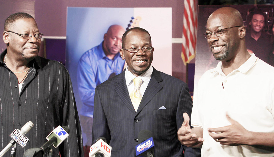 Wayman Tisdale's brothers (from left) Danny Tisdale, Rev. Weldon Tisdale and William Tisdale smile as they recount events when they were children during a press conference at Rev. Tisdale's Church in Tulsa. Photo by Michael Wyke, Tulsa World