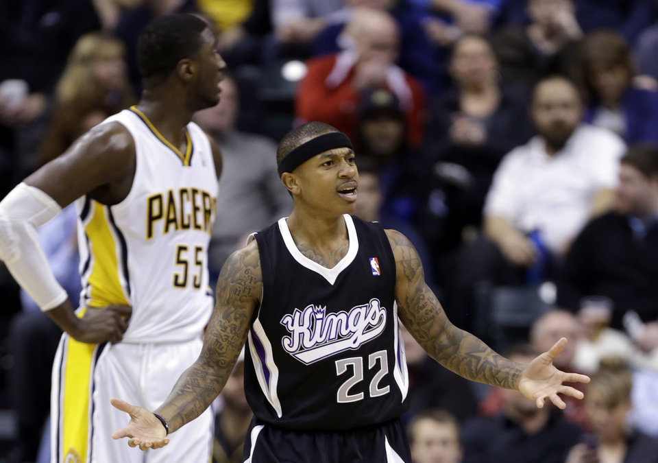 Photo - Sacramento Kings guard Isaiah Thomas (22) questions the lack of a call in front of Indiana Pacers center Roy Hibbert in the first half of an NBA basketball game in Indianapolis, Tuesday, Jan. 14, 2014. (AP Photo/Michael Conroy)