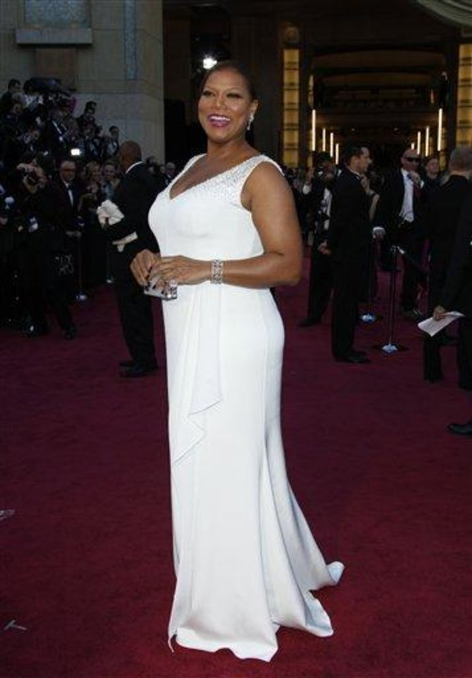 Photo - Queen Latifah arrives at the Oscars at the Dolby Theatre on Sunday Feb. 24, 2013, in Los Angeles. (Photo by Carlo Allegri/Invision/AP)