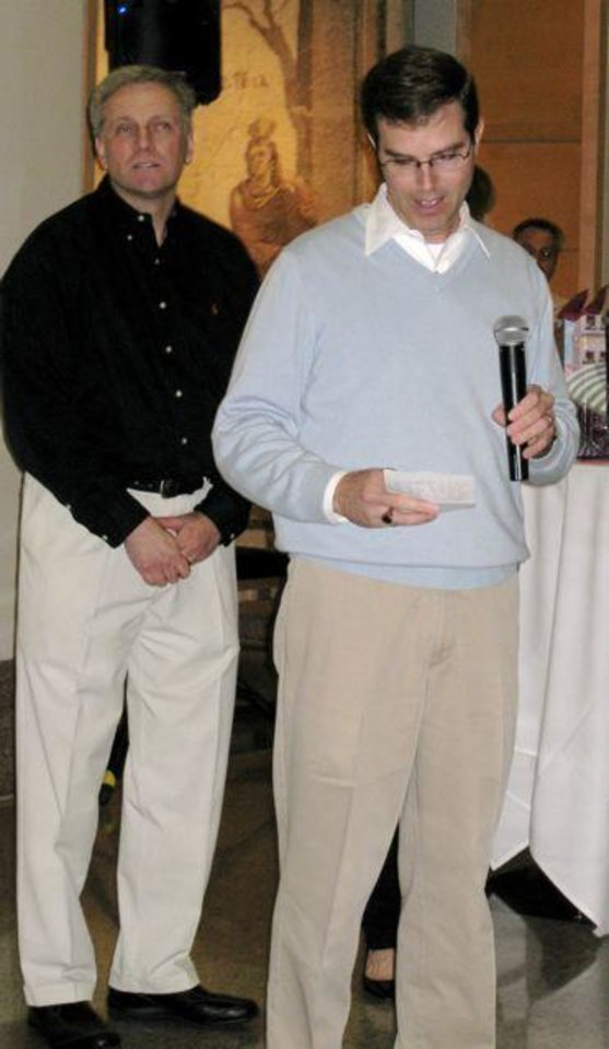 TWINS....Dr. Craig Abbott and Judge Tim DeGiusti take the microphone   during the party. (Photo by Helen Ford Wallace).