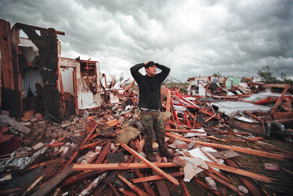 MAY 3, 1999 TORNADO: Tornado damage, victims: Tony Mahan stands amid the remains of his mother-in-law's house on SE 9th in Midwest City.  Lena Klepackie, (mother-in-law), and four adults huddled over four children , including a six month old baby, in the hallway (at left) as the tornado destroyed the house. No one was injured.
