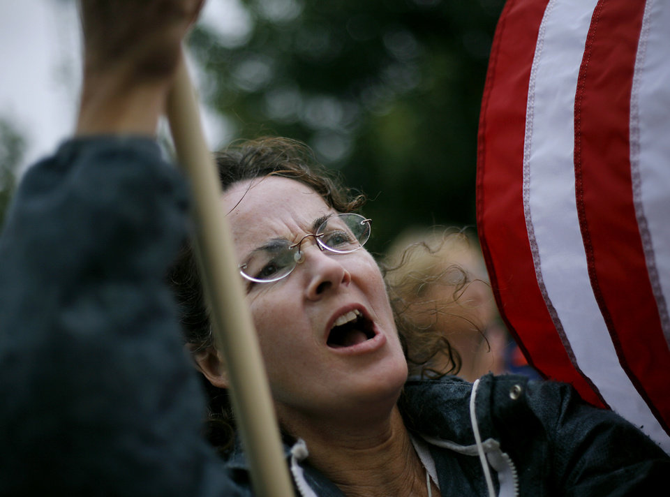 Photo - Sharon Gricol, of McLoud, Okla., shouts her approval to a speaker as she watches a Health Care Reform rally on the north side of the State Capitol in Oklahoma City on Sunday, Sept. 13, 2009.  By John Clanton, The Oklahoman