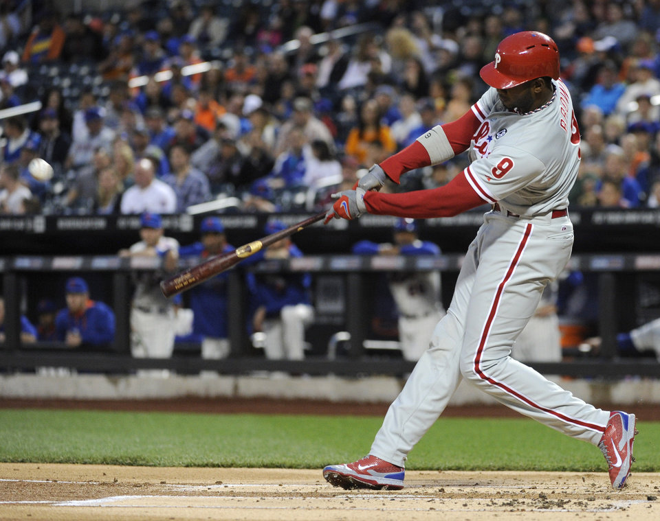 Photo - Philadelphia Phillies' Domonic Brown hits an RBI-single during the first inning of a baseball game against the Ne York Mets, Saturday, May 10, 2014, at Citi Field in New York. (AP Photo/Bill Kostroun)