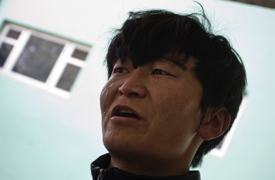 Tibetan Dawa Dhondup, 30, reacts at the zonal hospital in Dharmsala, India, on the anniversary of a failed 1959 uprising against Chinese rule, after his attempt to set himself on fire was aborted on Sunday, March 10, 2013. Police in India prevented a Tibetan man from setting himself on fire as hundreds of Tibetan exiles gathered to mark the anniversary in Dharmsala, the home of Tibet's government in exile. (AP Photo/ Ashwini Bhatia)