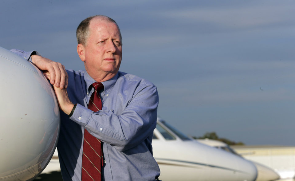 """This Thursday, Oct. 25, 2012 photo shows Harvey Martin, a pilot, at the Birmingham Shuttlesworth International Airport in Birmingham, Ala. After being laid off in late 2010, Martin was thrilled to return to the cockpit in summer 2012. """"Talk about an office with a view,"""" he says. """"Things are improving,"""" he says, noting a jobless friend recently found work. """"The recession that had been hanging over our heads - hopefully we've learned from that. ... No, things are not as good as they were four years ago when they were really rocking along. But the company is growing. My situation is good. I'm working again. It was just the luck of the draw."""" (AP Photo/Dave Martin)"""