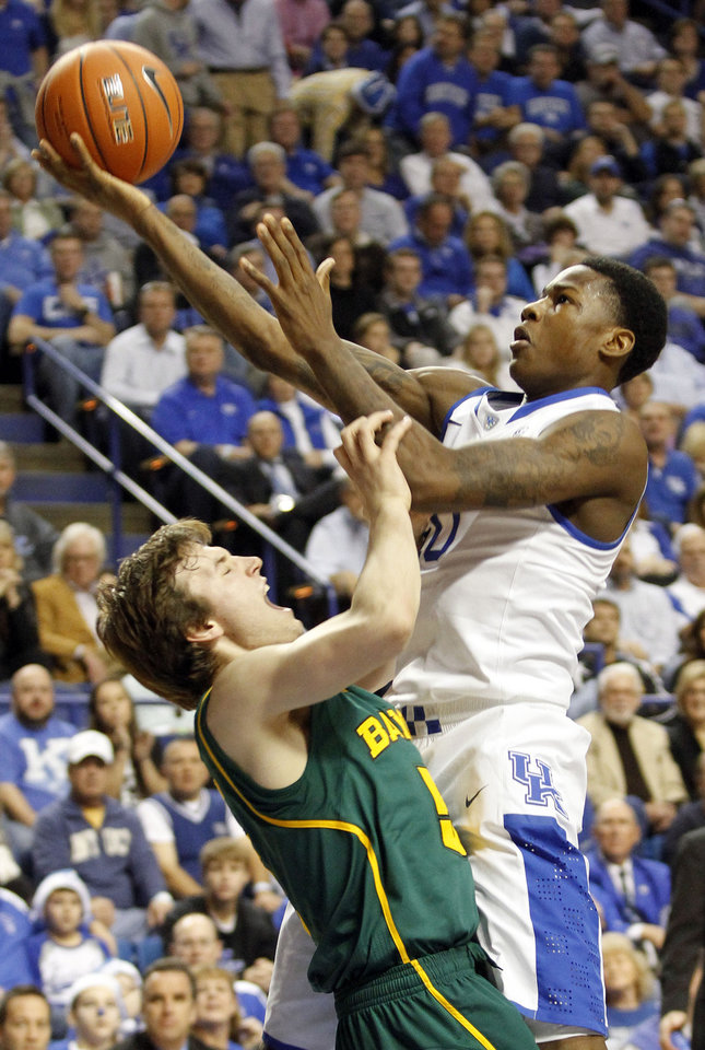 Photo - Kentucky's Archie Goodwin, right, shoots over Baylor's Brady Heslip during the first half of an NCAA college basketball game at Rupp Arena in Lexington, Ky., Saturday, Dec. 1, 2012. (AP Photo/James Crisp)