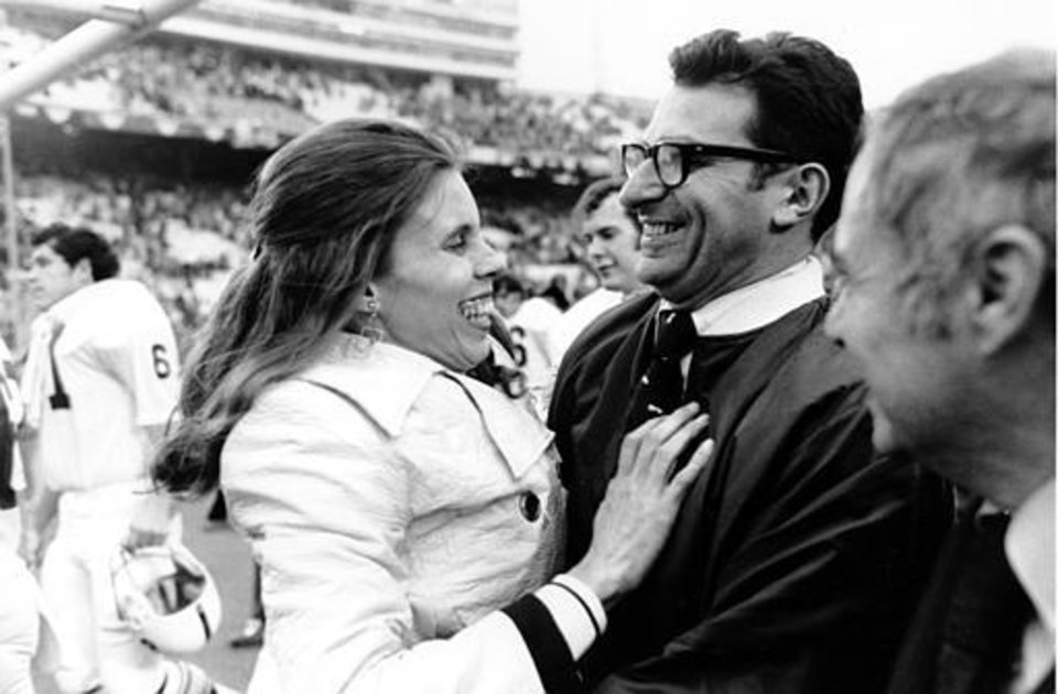 Photo - Penn State football coach Joe Paterno is embraced by his wife, Sue, following Penn State's victory over Texas in the Cotton Bowl in Dallas, Tx., on Jan. 1, 1972.  The Lions beat the Longhorns 30-6.  (AP Photo)