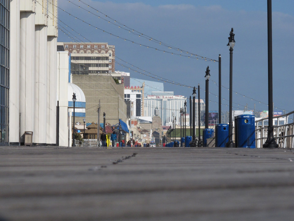 In this Wednesday, Feb. 6, 2013 photo, the Atlantic City, N.J., Boardwalk is nearly deserted on a cold mid-week day during what is the slowest period of the year for the gambling resort. New Jersey Gov. Chris Christie vetoed a bill Thursday, Feb. 7, that would have allowed Internet gambling in his state to help the struggling casinos. But Christie said he would sign a future bill that sets a 10-year trial period for Internet gambling, and increases the tax rate casinos would pay on their online winnings to 15 percent. (AP Photo/Wayne Parry)