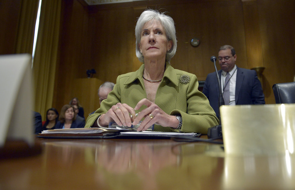 Photo - Health and Human Services Secretary Kathleen Sebelius listens on Capitol Hill in Washington, Thursday, April 10, 2014, during the Senate Finance Committee hearing on the HHS Department's fiscal Year 2015 budget. Sebelius said 7.5 million Americans have now signed up for health coverage under President Barack Obama's health care law. That's a 400,000 increase from the 7.1 million that Obama announced last week at the end of the law's open enrollment period. The figure exceeded expectations, a surprise election-year success for the law after a disastrous roll-out.   (AP Photo/Susan Walsh)