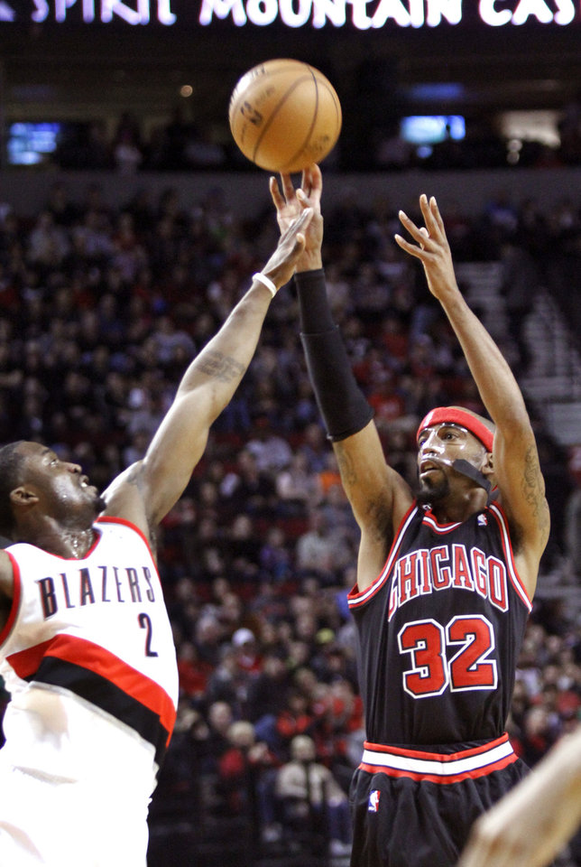 Chicago Bulls guard Richard Hamilton, right, shoots over Portland Trail Blazers guard Wesley Matthews during the first quarter of their NBA basketball game in Portland, Ore., Sunday, Nov. 18, 2012. (AP Photo/Don Ryan)