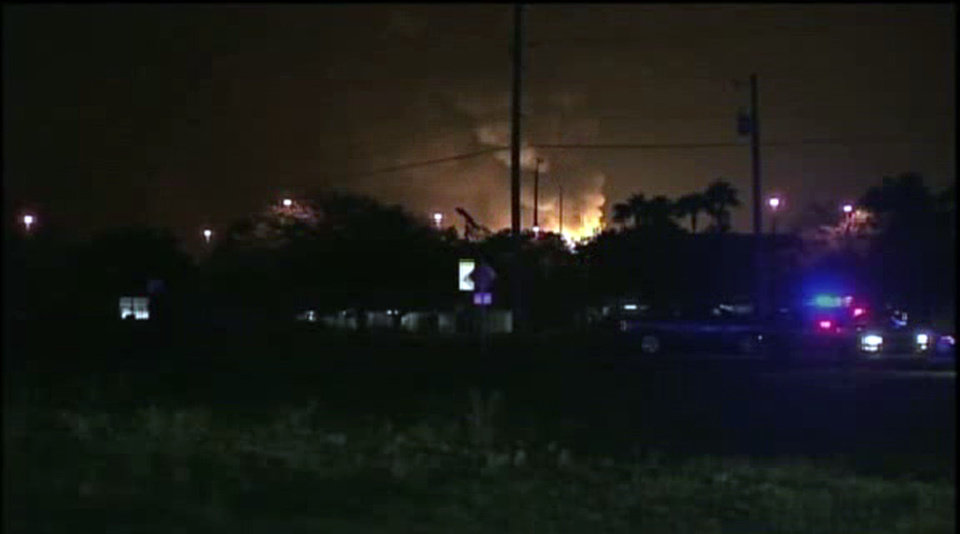 This image taken from Associated Press video shows flames from a gas plant explosion in Tavares City, Fla., Monday July 29, 2013. All the workers at the Florida propane gas plant rocked by massive explosions were accounted for early Tuesday morning after officials initially could not account for more than a dozen employees.  John Herrell of the Lake County Sheriff's Office said early Tuesday that there were no fatalities despite massive blasts that ripped through the Blue Rhino propane plant late Monday night. Seven people were injured and transported to local hospitals. (AP video)