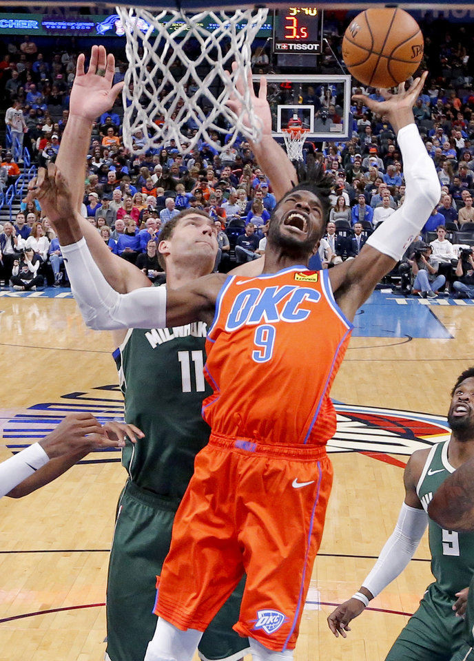 Photo - Oklahoma City's Nerlens Noel (9) fights for a rebound with Milwaukee's Brook Lopez (11) during the NBA game between the Oklahoma City Thunder and the Milwaukee Bucks at Chesapeake Energy Arena,   Sunday, Nov. 10, 2019.  [Sarah Phipps/The Oklahoman]