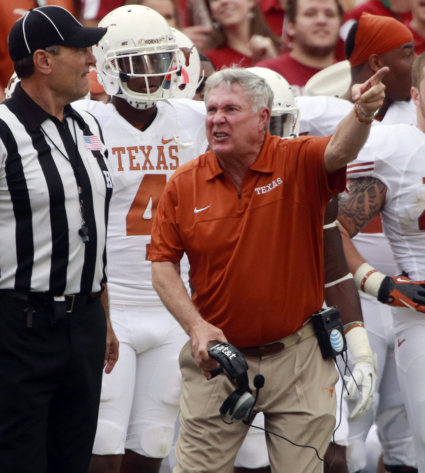 Photo -   Texas head coach Mack Brown yells at an official during the first half of an NCAA college football game against Oklahoma at the Cotton Bowl Saturday, Oct. 13, 2012, in Dallas. (AP Photo/Michael Mulvey)