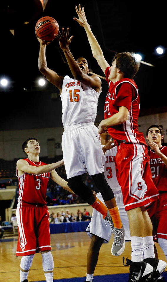 """Photo - Douglass' Patrick McKaufman is guarded by 6' 8"""" Matt Lea as the Stilwell Indians play the Douglass Trojans in the finals of the State Class 4A Boys Basketball Tournament at the Fairgrounds Arena on Saturday, March 15, 2014, in Oklahoma City, Okla. Photo by Steve Sisney, The Oklahoman"""