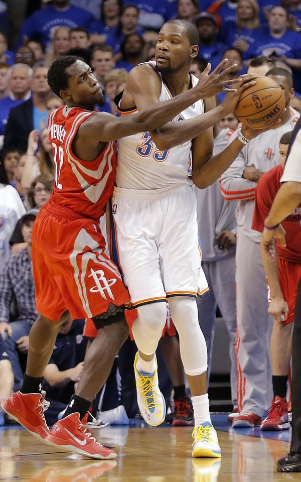 Houston's Patrick Beverley (12) defends on Oklahoma City's Kevin Durant (35) during Game 2 in the first round of the NBA playoffs between the Oklahoma City Thunder and the Houston Rockets at Chesapeake Energy Arena in Oklahoma City, Wednesday, April 24, 2013. Photo by Chris Landsberger, The Oklahoman