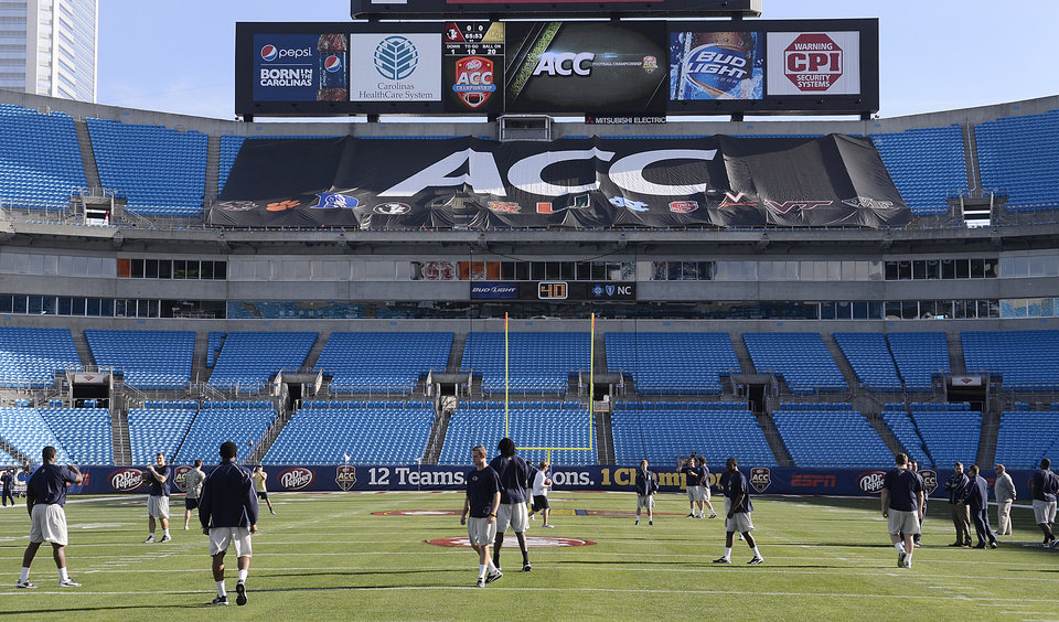 Georgia Tech walk on the field during a walk through of the stadium on on Friday, Nov. 30, 2012, in advance for Saturday's ACC Championship NCAA college football game against Florida State. (AP Photo/The Charlotte Observer,  John D. Simmons) LOCAL TV OUT (WSOC, WBTV, WCNC, WCCB); LOCAL PRINT OUT (CHARLOTTE BUSINESS JOURNAL, CREATIVE LOAFLING, CHARLOTTE WEEKLY, MECHLENBURG TIMES, CHARLOTTE MAGAZINE, CHARLOTTE PARENTS) LOCAL RADIO OUT (WBT)  ORG XMIT: NCCHN203