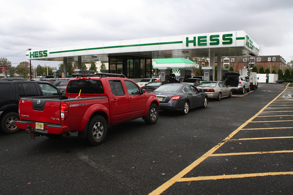Photo - Cars line up for fuel at the Hess station on U.S. 9 North Woodbridge, N.J, Tuesday, Oct. 30, 2012. Eight oil refineries that make up about 8 percent of U.S. refining capacity sit in the area hit by Hurricane Sandy. Nearly all of them were affected by the superstorm.  (AP Photo/Peter Hermann, III)  ORG XMIT: NYR106