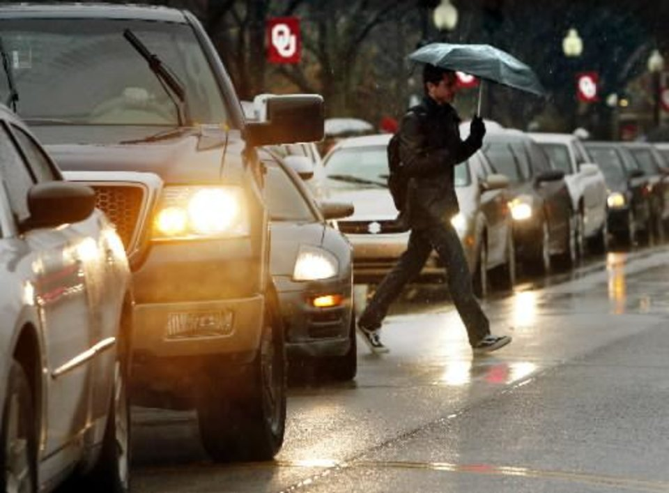 Traffic backs up on Lindsey Street as students head to class in the rain on the campus of the University of Oklahoma (OU) on Tuesday, Feb. 12, 2013 in Norman, Okla. Photo by Steve Sisney