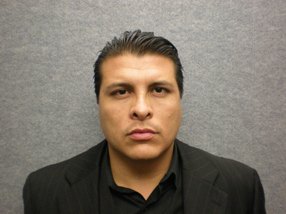 Photo -   This photo provided by the Orange Police Department shows the undated booking photo for Shazer Fernando Limas, 31, who was arrested early Friday May 4, 2012 following the chase on Interstate 5. He is suspected of killing his girlfriend, Arlet Hernandez Contreras, 31, and the couple's two young boys. (AP Photo/Orange Police Department)