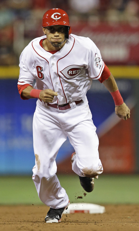 Photo - Cincinnati Reds' Billy Hamilton leaves second base on a double by Todd Frazier in the seventh inning of a baseball game against the St. Louis Cardinals, Tuesday, Sept. 3, 2013, in Cincinnati. Hamilton scored the only run of the game on the hit as the Reds won 1-0. (AP Photo/Al Behrman)