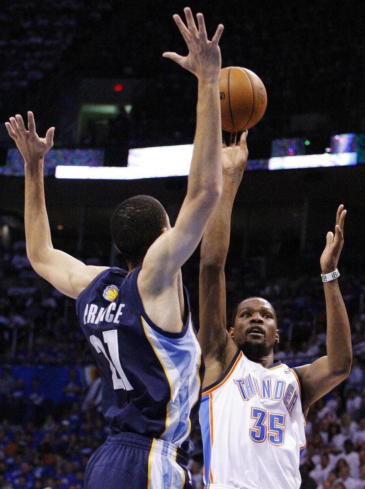 Photo - Oklahoma City Thunder forward Kevin Durant (35) shoots over Memphis Grizzlies Tayshaun Prince (21) during the first half of Game 2 of their Western Conference Semifinals NBA basketball playoff series in Oklahoma City, Tuesday, May 7, 2013. (AP Photo/Alonzo Adams)